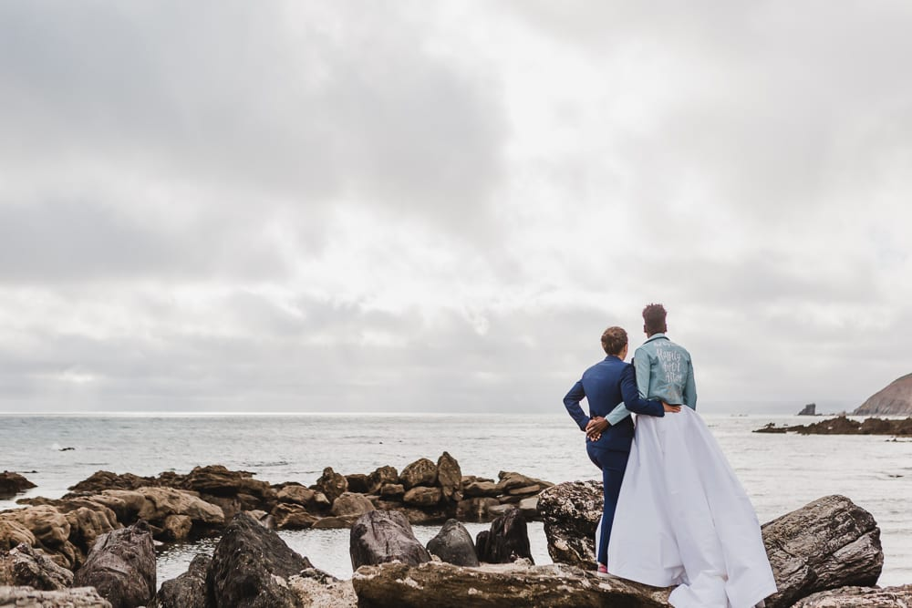 Brides look out to sea in Cornwall wedding pictures