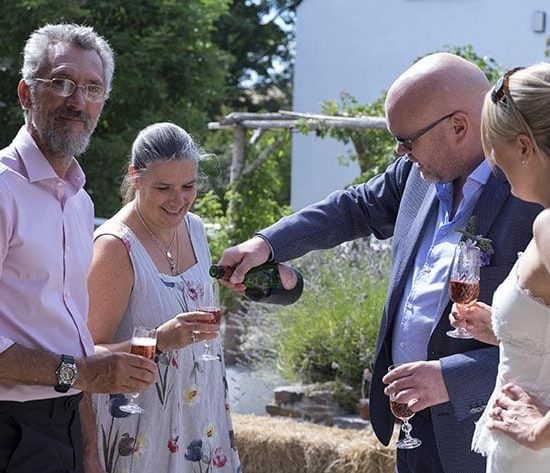 Wedding guests drinking Champagne at The Cow Shed