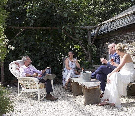 Bride and groom sipping Champagne at The Cow Shed Cornwall